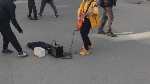 Street Performing Kid Shreds Classic 'Metallica' Song On Guitar