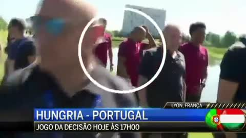 VIDEO: Angry Cristiano Ronaldo throws a Portuguese reporter's microphone in a lake