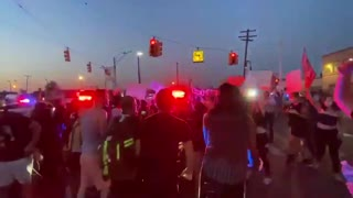 Detroit police SUV drives through crowd of protesters