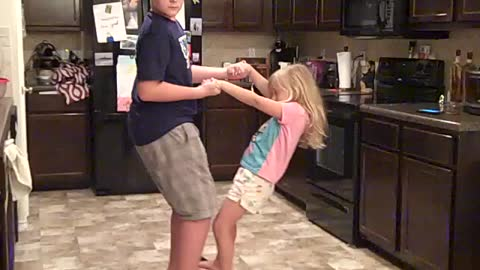 Big Brother Dances With His Little Sister On His Hoverboard