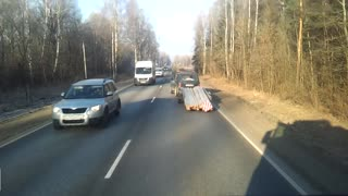 A really heavy trailer vs a little car