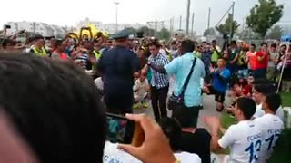 Police Officer Dances with Refugees