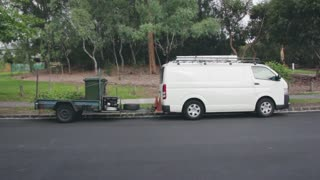 White Van With Compressor In Streets