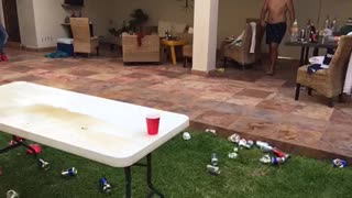 Beer pong dunk outside black and white shorts no shirt - Video