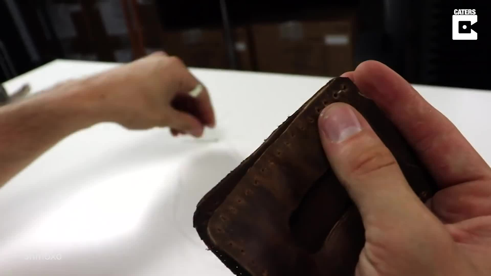 WHAT A BOOT-IFUL GIFT: ARTIST SHOWS CRAFTY WAY TO CREATE A STYLISH WALLET FROM AN OLD DISCARDED BOOT