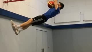 Guy jumps off a trampoline, slam dunks and lands face first into safety pad