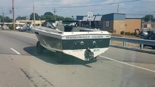 Man Drives His Boat Down The Road Like A Car
