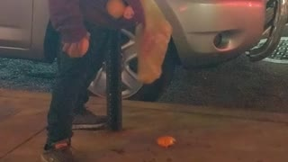 Drunk man tries to pick up oranges and put in bag - Video