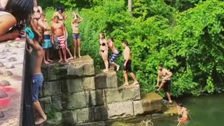 Guy back flip off bridge belly flop lake river water