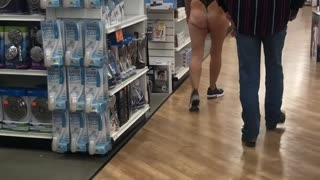 Woman Dons Lingerie in Retail Store