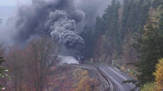 Steam Train Racing Across Picturesque Autumn Surroundings - Video