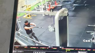Guy at gym gets sent flying by the cable machine
