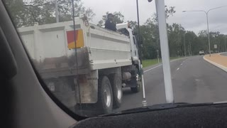 Police Ride Unsecured in Back of Utility Truck