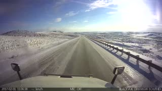 Semi Truck Rolls Down Mountain in Icy Conditions - Video