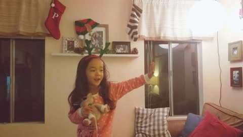 Little girl humorously explains meaning of Christmas