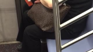 Lady clipping nails on subway