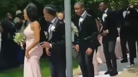 Wedding party delivers synchronized entrance dance