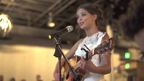 Bride toasts groom with surprise wedding song