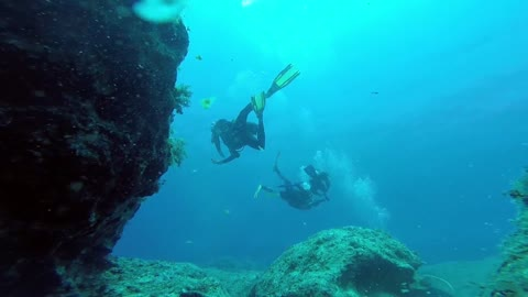 Divers under the cave