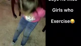 Little girl in pink does different exercises - Video