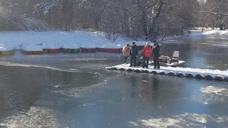 Brave Man Rescues Dog From Frozen Pond - Video