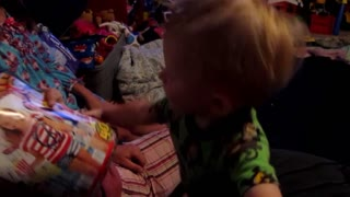 Cute Tot Steals His Sister's Magazine - Video