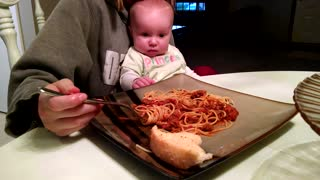 Adorable Baby Girl Demands Mom To Feed Her Spaghetti - Video