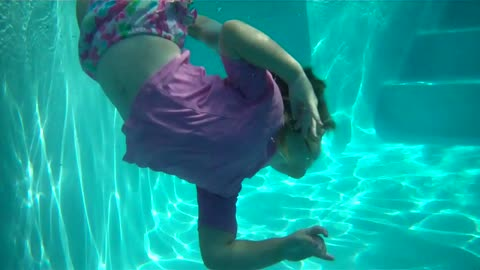 Two and a half year old twirling underwater!  So carefree!
