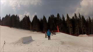 Snowboarder wipes out after hitting jump - Video