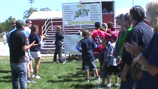 Peewee Football Team Demonstrates The Domino Effect - Video
