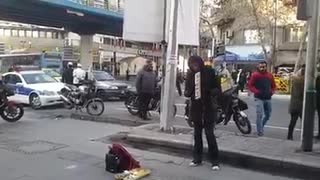 Girl playing music in street of Tehran - Video
