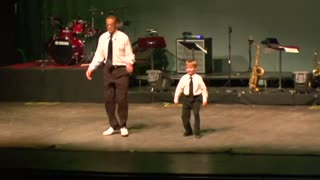 Tap dance showdown between toddler and seasoned pro - Video
