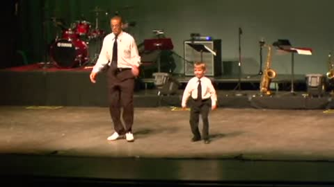 Tap dance showdown between toddler and seasoned pro