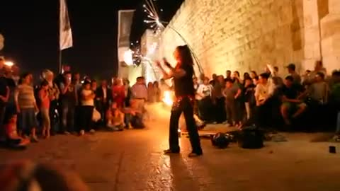 Girls juggling with fire, at the Jerusalem Festival of Lights