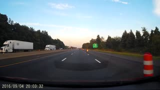 Tire Across Highway Smashes Car's Front End. - Video