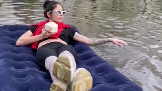 Relaxing on A Float Down A Flooded Street