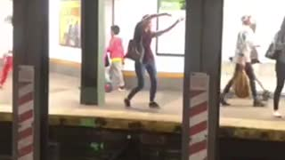 Blonde woman striped shirt dance on subway platform