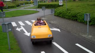 Children Driving Cars And Spend A Good Day On A Very Beautiful Place  - Video