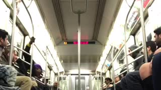 Man in purple hat performs on subway