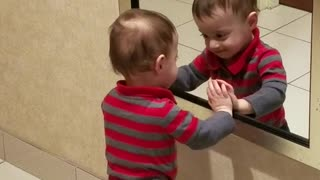Boy Loves To Joke Around With His Reflection In The Mirror - Video