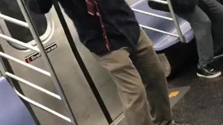 Man red flannel black jacket dancing on train
