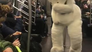 Person in large white bear costume on subway  - Video