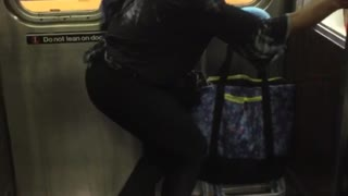Blonde woman dancing next to subway train door - Video