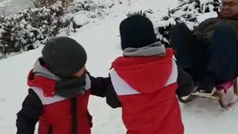 Kids pull dad in sleigh in Poland