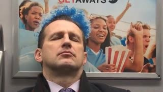 Man with blue hair suit cane