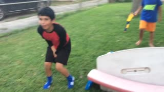 Kid Destroys Picnic Table With Epic Swing Set Jump - Video