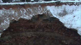 A huge hole in the ground on a flooded mine in Russia in the Urals city of Solikamsk