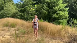 Mom Juggles 5 Balls While Holding Baby