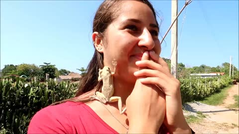 Witness the moment a frog jumps right on this girl's face!