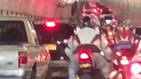 Motorcycle Gang drive reckless in gridlock traffic